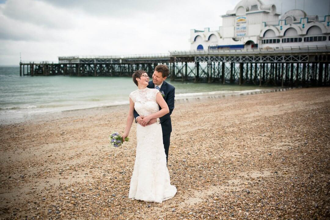 Happy bride and groom at Southsea pier for portsmouth beach wedding